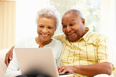 Senior African American couple using laptop Stock Image