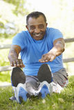 Senior African American Man Exercising In Park Royalty Free Stock Photos