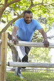 Senior African American Man Exercising In Park Royalty Free Stock Photography