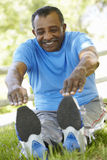 Senior African American Man Exercising In Park Stock Photo