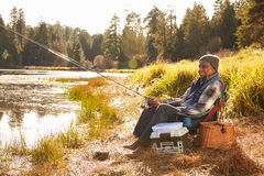 Senior African American Man Fishing By Lake Stock Photography