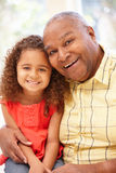 Senior African American man and granddaughter. Senior African American men and granddaughter Stock Photos