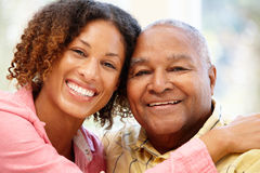 Senior African American man and granddaughter stock photos