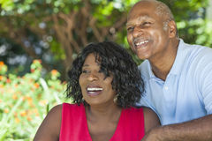 Senior African American Man & Woman Couple. A happy senior African American men and women couple in their sixties outside together smiling Stock Photo
