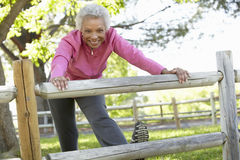 Senior African American Woman Exercising In Park Stock Photography