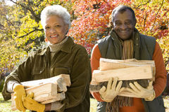 Senior African couple carrying firewood Stock Image