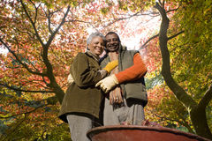 Senior African couple doing yard work in autumn Stock Photo
