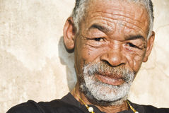 Senior African man. Relaxing in the African sun stock image