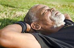 Senior African man. Relaxing in the African sun stock photos