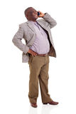 Senior african man talking cell phone. Cheerful african man talking on cell phone isolated on white background Stock Photo