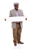 Senior african man white board. Happy senior african man holding blank board over white background Stock Photos