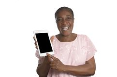 Senior african woman with tablet PC Stock Photo