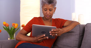 Senior African woman using tablet Stock Photo