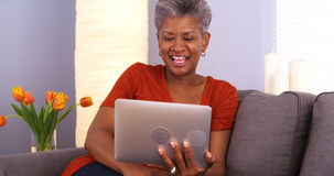 Senior African woman webcamming on tablet Stock Photo