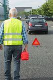 Senior aged man holding gas can to refill car. Senior aged man holding gas can to refill his car royalty free stock photo
