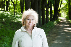 Senior aged woman outdoors in forest Royalty Free Stock Image