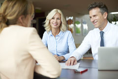 Senior agent and her clients planning business investment Royalty Free Stock Photos