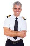 Senior airline captain Stock Photo