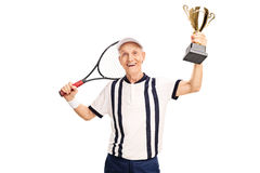 Senior amateur tennis player holding a trophy. Senior amateur tennis player holding a golden trophy and smiling isolated on white background Stock Images