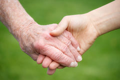 Senior And Young Women Holding Hands Royalty Free Stock Image