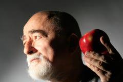 Senior with apple Stock Photo