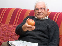 Senior with an apple Stock Photo