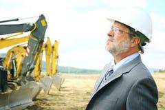 Senior Architect. A senior architect supervising a construction site Royalty Free Stock Photography