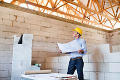 Senior architect or civil engineer at the construction site. Royalty Free Stock Photos