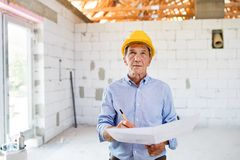 Senior architect or civil engineer at the construction site. Stock Image