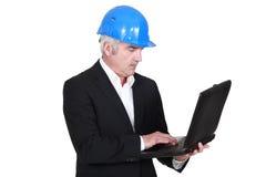Senior architect with computer Stock Image