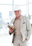 Senior architect with a hardhat holding blueprints Royalty Free Stock Image