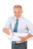 Senior architect male handshake hold blueprints stock images