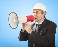 Senior architect shouting into megaphone. Portrait of senior architect shouting into megaphone on sky Stock Images