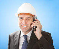 Senior architect talking on walkie-talkie Stock Photo