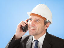 Senior architect talking on walkie-talkie Royalty Free Stock Photo