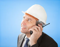 Senior architect talking on walkie-talkie Royalty Free Stock Photos