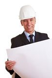 Senior architect at work. Smiling senior architect with building prints at work Royalty Free Stock Photos
