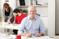 Senior architect working in studio Stock Images