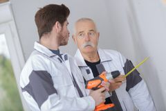 Senior architect and young builder discussing new project Stock Photo