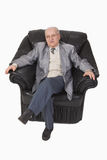 Senior in an armchair Stock Photo