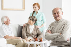 Senior with arms crossed. Senior men smiling and sitting with arms crossed royalty free stock image
