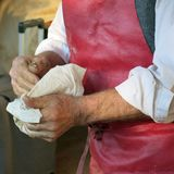 Senior artisan washes his hands after work in the handicraft wor Royalty Free Stock Image