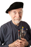Senior artist with beret and brushes Royalty Free Stock Photography
