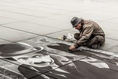 Senior artist during drawing Charlie Chaplin - Paris. Royalty Free Stock Images
