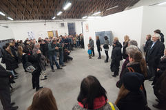 Senior artist giving speech to crowd at art gallery museum exhibition opening Stock Photography