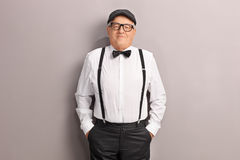 Senior in artistic clothes posing in front of a wall royalty free stock images
