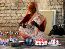 Senior Artwork. A poor senior Indian woman paints small clay toys on the occasion of Diwali in India Stock Images
