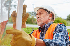 Senior as competent window fitter. Installing new window Stock Photos