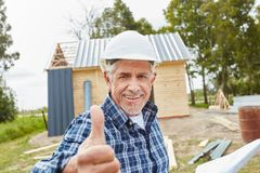Senior as master craftsman. Holding thumbs up royalty free stock images