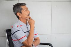 Senior Asia businessman sit and  thinking stock photo
